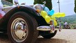 Reveal of a vintage car with balloons.