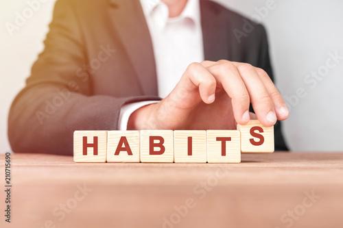 Fotografia  Man made word HABITS with wood blocks