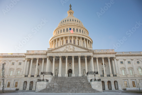 Fotografia, Obraz  Wide view of the front of the US Capitol Building in Washington, DC without any people and a bright blue sky