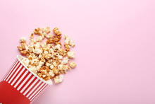Caramel Popcorn In Striped Bucket On Pink Background
