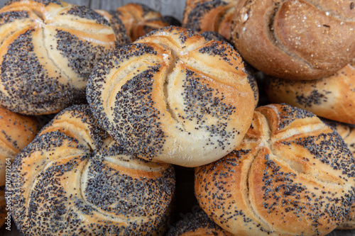 Deurstickers Brood Beautiful bread; poppy seed roll, plain, sesame seed, onion, french baguette and salted rye