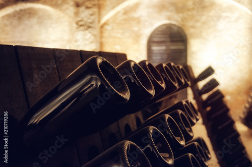 Pupitre and bottles inside an underground cellar for the production of tradition Wallpaper Mural
