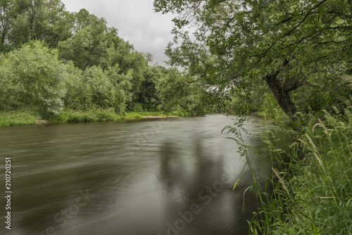 Foto op Aluminium Rivier Ohre river in dark summer day