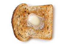 A Single Slice Of Whole Wheat Toast With A Knob Of Melting Butter Isolated On White From Above.