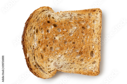 Photo A single slice of whole wheat toast isolated on white from above.