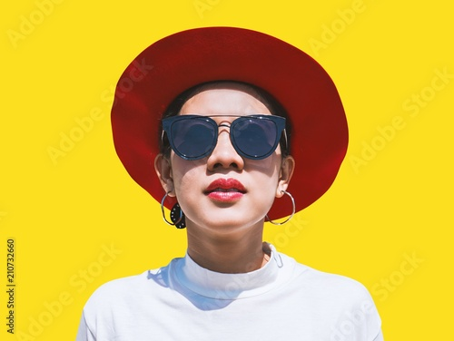 Portrait of young woman in hat and sunglasses