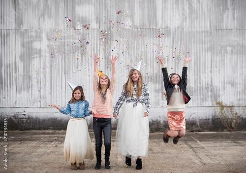 Four girls celebrating