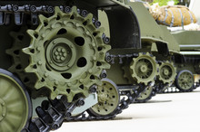 Tank Tracks And Steel Wheels Of Heavy Armored Vehicles With Green Bodywork In Row, Military Industry, Modern Army Equipment, Selective Focus