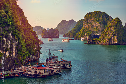 Fotografie, Obraz  Tourist Junks in Halong Bay,Panoramic view of sunset in Halong Bay, Vietnam, Sou