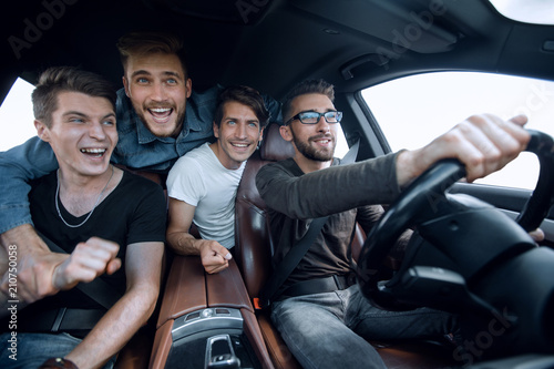 close up.happy friends talking in the car. Canvas Print