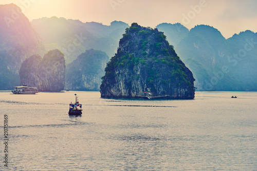 Canvas Prints Camping Fishing boat in Ha long Bay, Panoramic view of sunset in Halong Bay, Vietnam, Southeast Asia,UNESCO World Heritage Site
