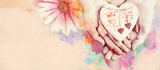 Heart in hand. Conceptual watercolor background.