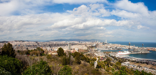 Fototapeta na wymiar Panorama of Barcelona harbour and city seen from Montjuic viewpoint