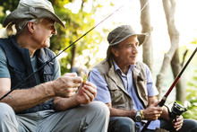 Senior Friends Fishing By The ...