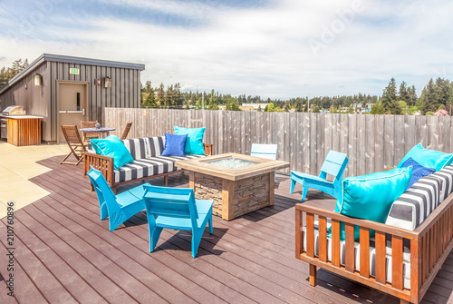 Obraz rooftop deck with modern blue patio furniture - fototapety do salonu
