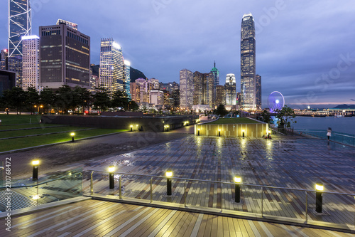 Stunning sunset view of the Central business district in Hong Kong island from the waterfront promenade along the Victoria harbor in Hong Kong, China