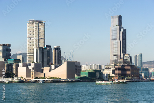 Kowloon skyline at Tsim Sha Tsui view from across the Victoria harbour in Hong Kong on a sunny day in China SAR.