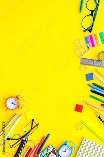 Papiers peints Pierre, Sable Education concept. Stationery for school pupil mockup with glasses and notebook on yellow background top view copy space