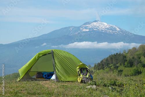 Vászonkép  Green Tent On Meadow In Front Of Etna Volcano, Sicily