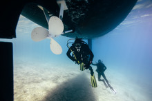 Two Technical Divers Repairing Ship Propeller Underwater