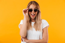 Portrait Of An Excited Young Blonde Girl In Sunglasses