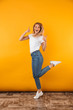 canvas print picture - Full length portrait of a cheerful young blonde girl