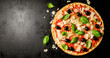 canvas print picture - Traditional italian pizza on dark table