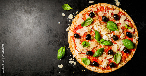 Traditional italian pizza on dark table Canvas Print