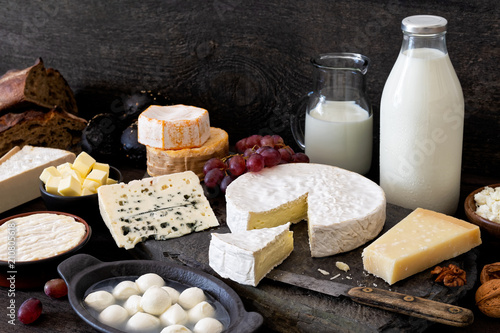 Fotobehang Zuivelproducten Cheese, milk and dairy products on rustic dark wood and slate background.