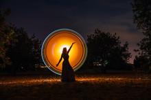 Female Silhouette In Glowing C...