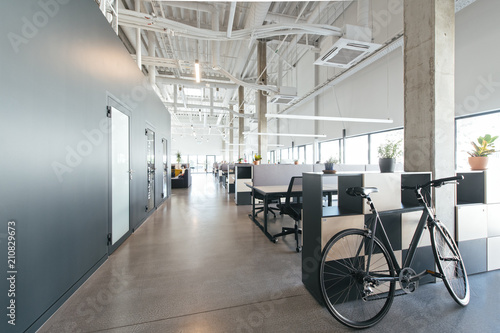 Contemporary office interior with bicycle