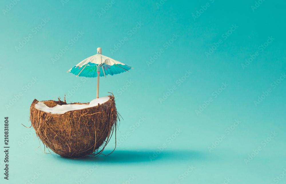 Fototapety, obrazy: Tropical beach concept made of coconut fruit and sun umbrella. Creative minimal summer idea.