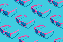Pink Sunglasses Pattern On Pastel Blue Background. Minimal Summer Concept.