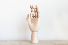 Hand Figurine On A Wooden Table
