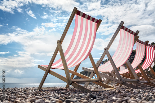 Canvas Print Deck chairs on the beach at the seaside summer vacation