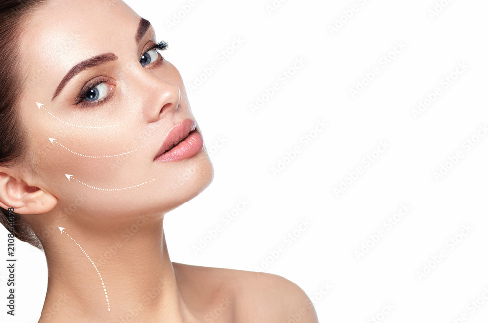 Fototapeta portrait of beautiful woman with perfect skin of the face, with arrows on face, concept of lifting skin. Cosmetology, elastic and young skin of the face.