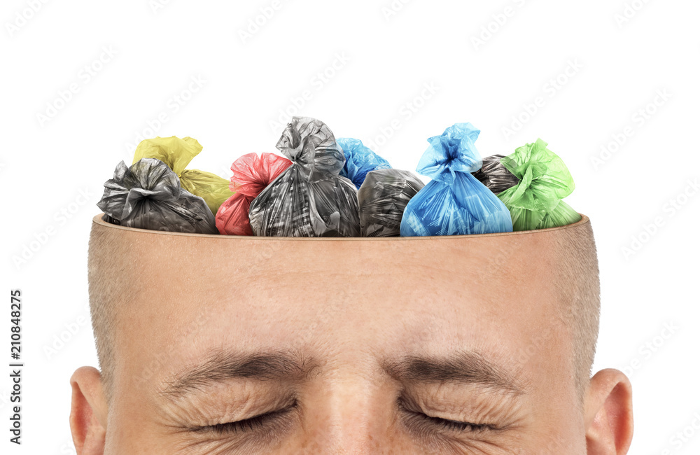 Fototapeta Сoncept of knowledge. Garbage bags is in cut of the head  on a white background. Unnecessary information.