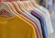 Leinwanddruck Bild - clothes on hangers in store