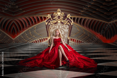 Obraz Blonde woman sitting on the throne - fototapety do salonu