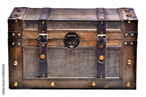 Fotografía Old wooden chest with ornamental forging and leather straps isolated on white ba
