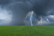 Green Field And Thunderstorm