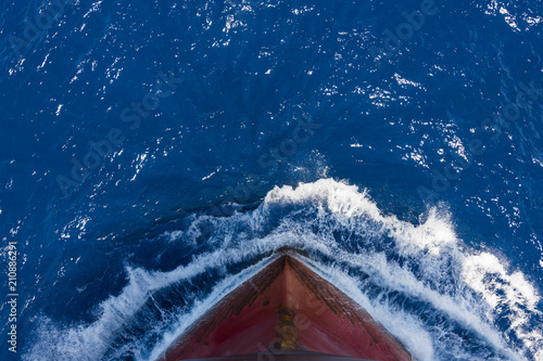 Fototapeta Ship's bow, moving through the waves to her destination