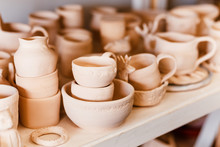 Empty Clay Pots Drying On A Sh...