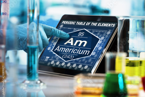 Scientist working on the digital tablet data of the chemical element Americium A Wallpaper Mural