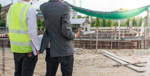 Engineer and Architect working at Construction Site Fototapeta