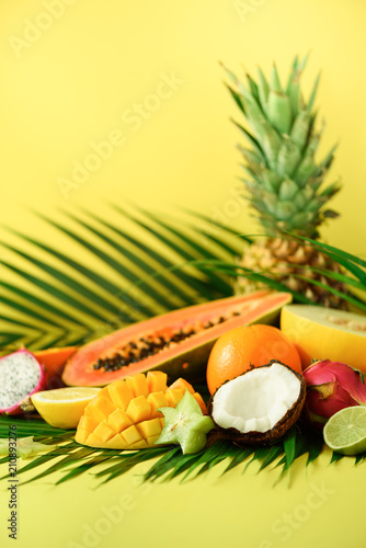 Fotografie, Tablou Assortment of exotic fruits on yellow background