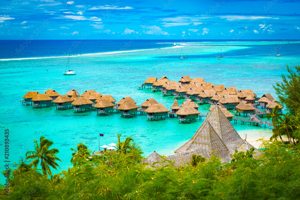 Fototapety, obrazy: Aerial view of overwater bungalow luxury resort in turquoise lagoon water of Moorea, French Polynesia.