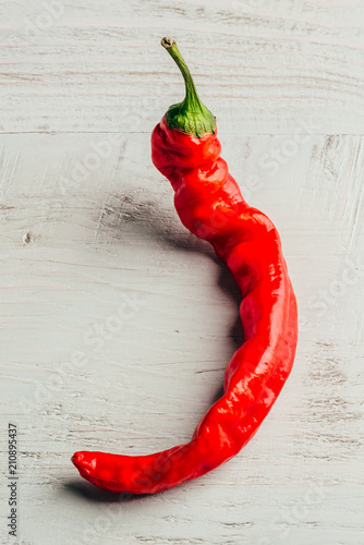 Staande foto Hot chili peppers Chili pepper on wooden background.
