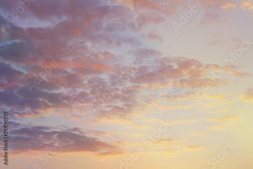 Foto op Plexiglas Zonsondergang bright evening cloudy sky at sunset.
