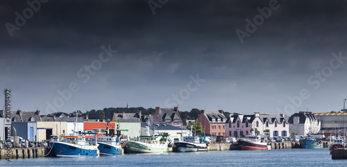 Stormy landscape of the main harbor in low tide, Guilvinec, Brittany, France Poster